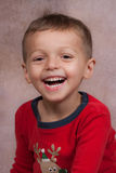 Laughing child. Young boy with red shirt laughing Stock Photo