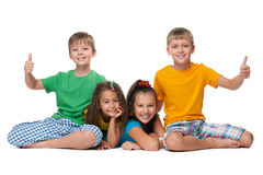 Laughing children hold their thumbs up Royalty Free Stock Photos
