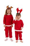 Laughing children in reindeer hair band Royalty Free Stock Photo