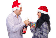 Laughing Christmas couple having fun Stock Images