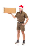 Laughing Christmas Messenger Holding Carton Box Royalty Free Stock Photography