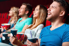 Laughing cinema visitor Stock Images