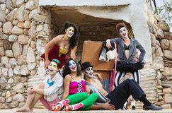 Laughing Cirque Ensemble. Lauging ensemble of bizarre circus clowns on stage Royalty Free Stock Photography