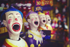 Laughing clowns at the fair ground Royalty Free Stock Photo