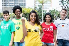 Laughing colombian sports fan with supporters from Mexico, Brazi. L, Germany and Russia outdoors on way to stadium Royalty Free Stock Photography