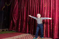 Laughing confident little boy on stage Royalty Free Stock Photography