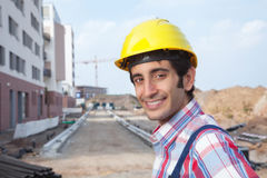 Laughing construction worker with black hair Royalty Free Stock Photos