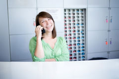 Laughing consultant speaking on phone Royalty Free Stock Image