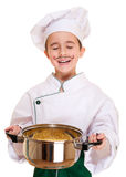 Laughing cookee boy in hood. With macaroni pot in hands isolated on white Royalty Free Stock Photos