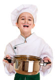 Laughing cookee boy in hood. With macaroni pot in hands isolated on white Stock Photography