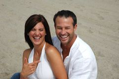 Laughing couple. Couple laughing it up on the beach Royalty Free Stock Photos