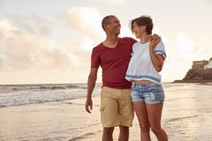 Laughing couple in the breaking waves Royalty Free Stock Image