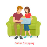 Laughing couple browsing the internet at the laptop Stock Photos