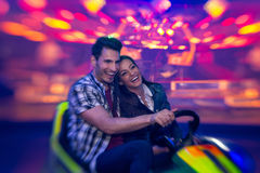 Laughing couple in bumper car - shoot with lensbaby Royalty Free Stock Photos