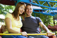 Laughing couple on the carousel Royalty Free Stock Photos