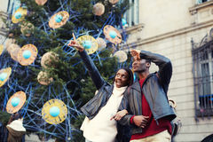 Laughing couple on christmas vacation walking in the city Stock Photography