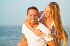 Laughing couple enjoying nature over sea background. Attractive Stock Photography