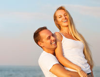Laughing couple enjoying nature over sea background Royalty Free Stock Images