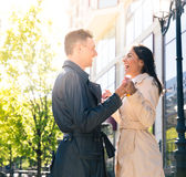 Laughing couple flirting outdoors Stock Image