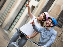Laughing couple going sightseeing by segways Royalty Free Stock Images