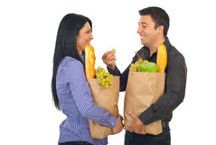Laughing couple having coversation at shopping Royalty Free Stock Photography