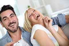 Laughing couple at home Royalty Free Stock Image