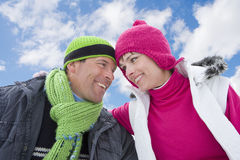 Laughing couple hugging against blue sky royalty free stock photos