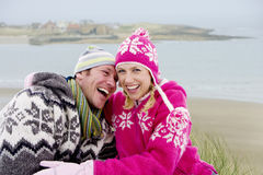Laughing couple hugging on remote beach royalty free stock photo
