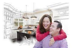 Laughing Couple With Kitchen Design Drawing and Photo Behind Stock Photos