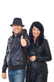 Laughing couple in leather give thumbs Stock Photo