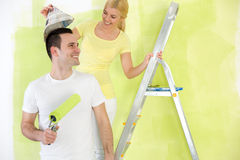 Laughing couple painting together Royalty Free Stock Image