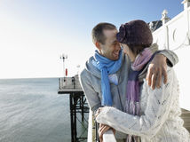 Laughing Couple By Sea On Pier Stock Photography