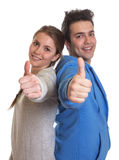Laughing couple showing thumbs at camera Stock Images