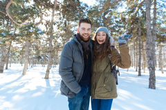 Laughing couple standing in winter park Stock Photo