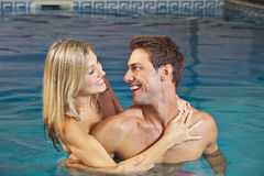 Laughing couple in swimming pool. Laughing happy couple in water in a swimming pool royalty free stock image