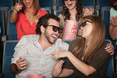 Laughing Couple In Theater. Couple with 3D glasses in theater laughing together Stock Image