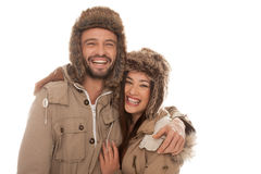 Laughing couple in winter fashion Stock Images