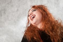Laughing crazy young woman Stock Photography