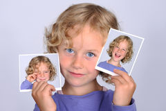 Laughing and weeping. Girl is showing two photos from her self Stock Photography