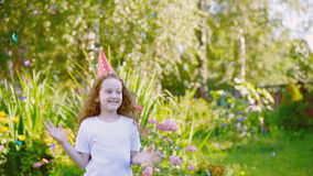 Laughing curly girl in carnival party hat stock video footage