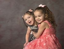 Laughing curly haired, little sisters royalty free stock photos