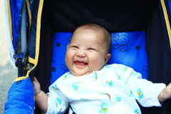 Laughing Cute baby. This cute baby is my daughter Royalty Free Stock Photo
