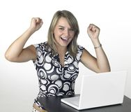 Laughing cute blond girl with laptop in light back Royalty Free Stock Photos