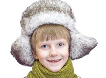 Laughing cute boy in winter cap stock photography
