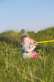 Laughing cute little boy sitting on grass Stock Photos