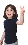 Laughing cute little girl shows V-sign stock images