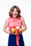 Laughing cute woman holding fruits Royalty Free Stock Photos