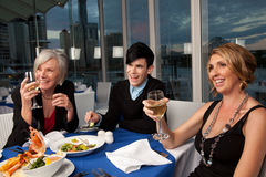 Laughing at Dinner Royalty Free Stock Images