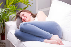 Laughing and discussing on a sofa Stock Photography