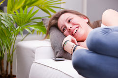 Laughing and discussing on a sofa Royalty Free Stock Photo